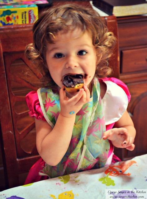 Toddler eating gluten-free doughnuts